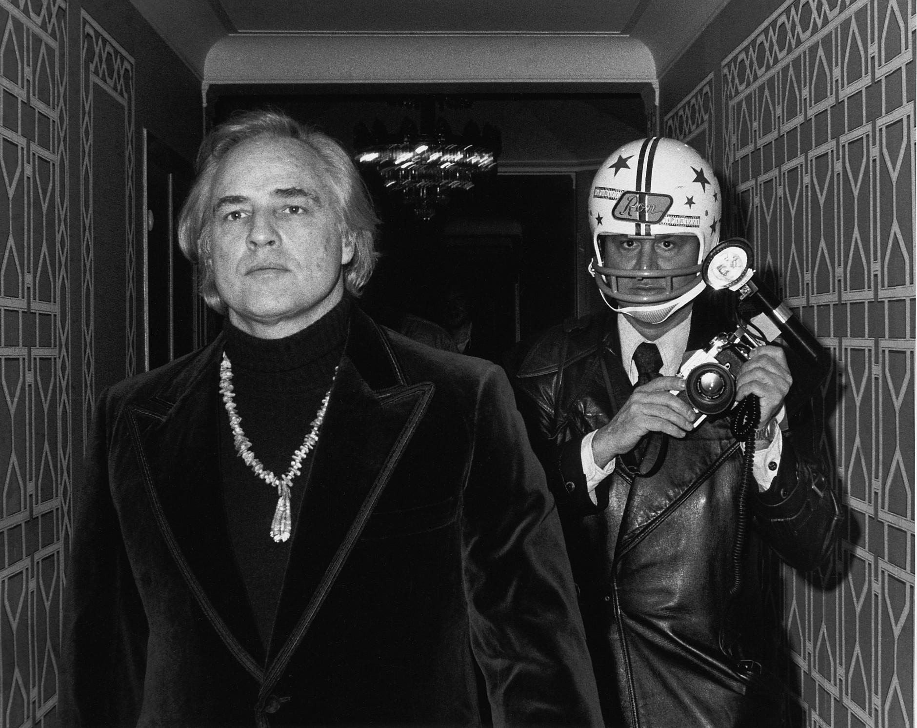 Paul Schmulbach: Guarding against the Godfather - Marlon Brando and Ron Galella, The Waldorf Hotel, New York, November 1974.  © Ron Galella, Ltd.