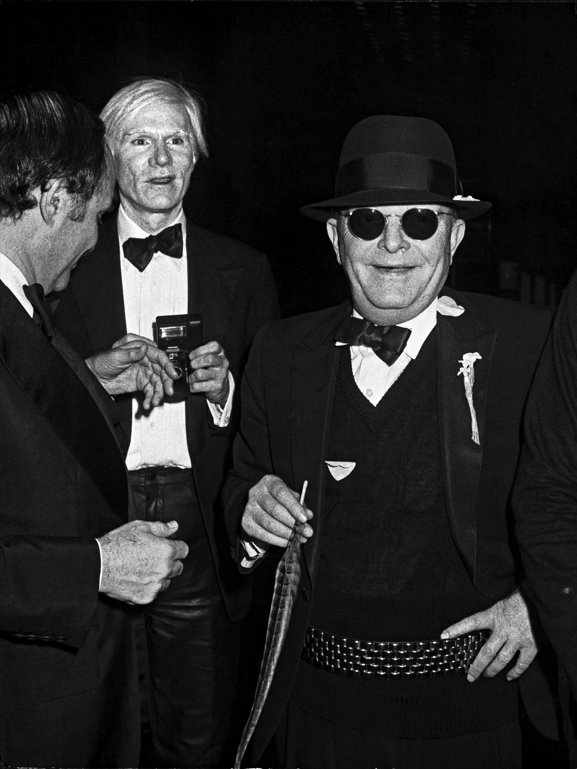 Ron Galella: Lester Persky, Andy Warhol and Truman Capote, New York, December 1978. © Ron Galella, Ltd.