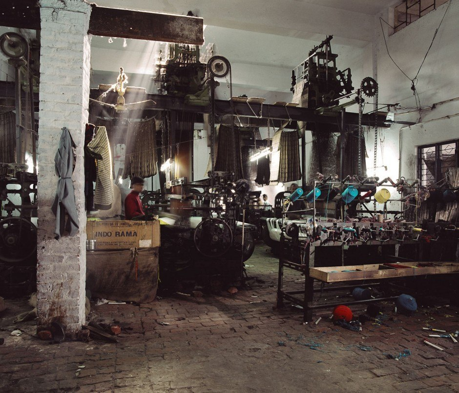 Tim Mitchell, Other factories house heavy old power looms used for weaving shoddy blankets. Shoddy weaving expanded rapidly in the 1980s, using machinery imported from Italy and Poland, 2005