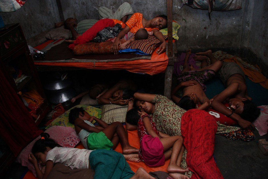 Taslima Akhter, The life and struggle of Garment workers, 11 member of a garment worker's family share the same room to survive, Mirpur, Bangladesh, 2009