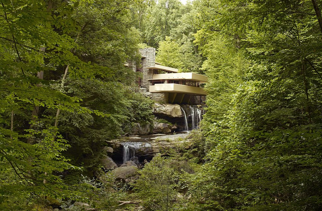 Fallingwater, also known as the Edgar J. Kaufmann Sr. Residence, is a house designed by American architect Frank Lloyd Wright in 1934 in rural southwestern Pennsylvania, 50 miles southeast of Pittsburgh, and is part of the Pittsburgh Metro Area. The house was built partly over a waterfall in Bear Run at Rural Route 1