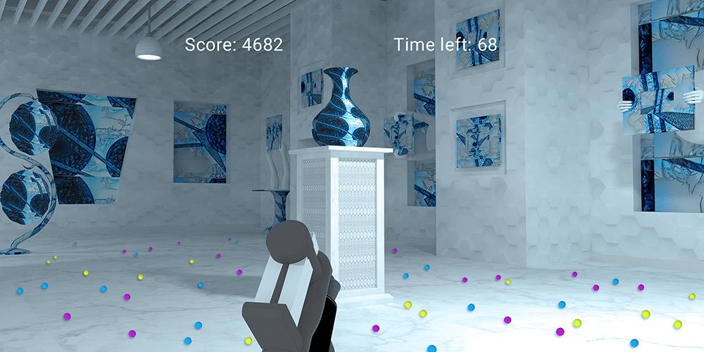 Virtueller Gallerie-Raum mit bunten Kügelchen auf dem Boden und einem Staubsaugergriff