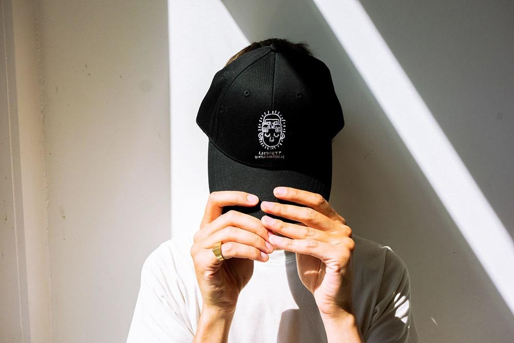 Merchandise / Baseballcap für »Durchbruch« von Liedfett. Gestaltet von Girlpunk™